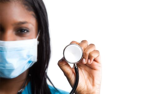 stethoscope: An isolated shot of an african american nurse wearing surgical mask and stethoscope (focus on the stethoscope)  LANG_EVOIMAGES