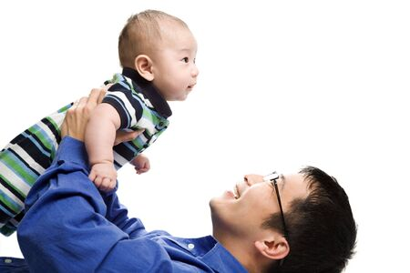 An isolated shot of an asian father playing with his son Stock Photo - 2918407