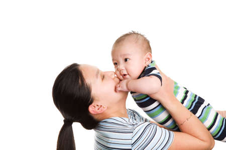 An isolated shot of an asian mother kissing her baby son Stock Photo - 2918405