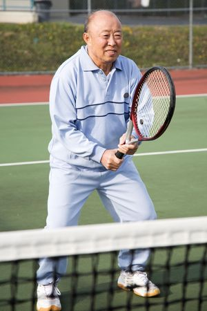 A shot of a senior asian man playing tennis Stock Photo - 2918409