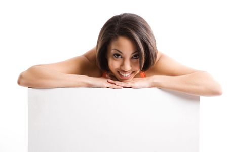 An isolated shot of a beautiful woman smiling and showing an empty billboard Stock Photo - 2940629