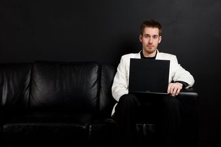 A shot of a caucasian businessman working on his laptop photo
