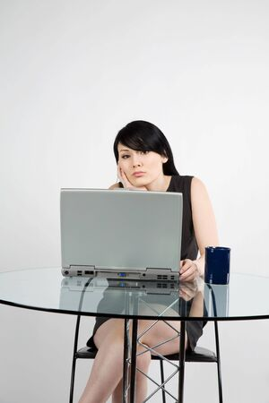 A shot of a beautiful businesswoman working at office photo