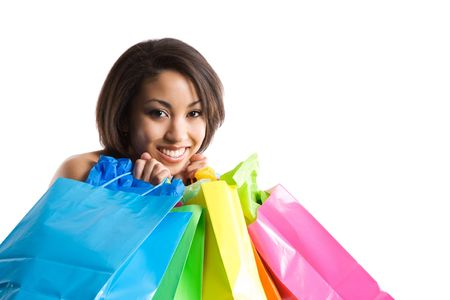 An isolated shot of a black woman carrying shopping bags Stock Photo - 2992948