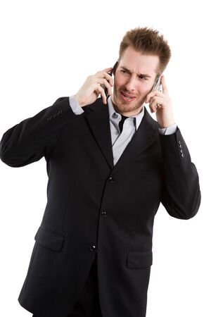 An isolated shot of a caucasian businessman talking on two cell phones photo