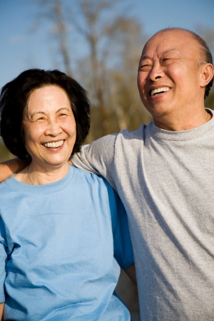 A shot of a senior asian couple having fun outdoor photo
