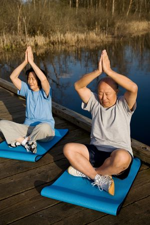 A shot of senior asian couple meditating and practicing yoga Stock fotó - 3031418