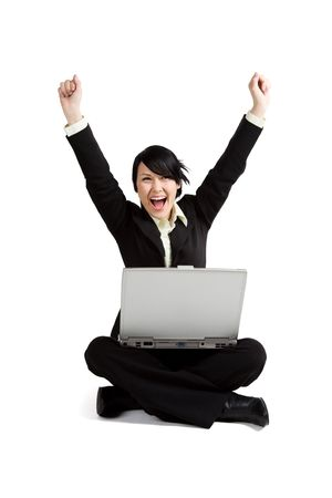 A shot of an excited businesswoman working on her laptop Stock Photo - 3039808