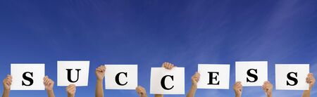 A shot of hands holding success sign against blue sky Stock Photo - 3068446