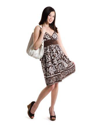 An isolated shot of a beautiful asian woman carrying a handbag photo