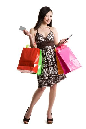 An isolated shot of a beautiful asian woman carrying shopping bags Stock Photo - 3079770