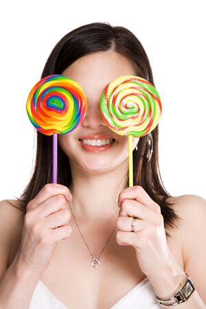 An isolated shot of a beautiful asian woman holding two lollipops covering her eyes photo