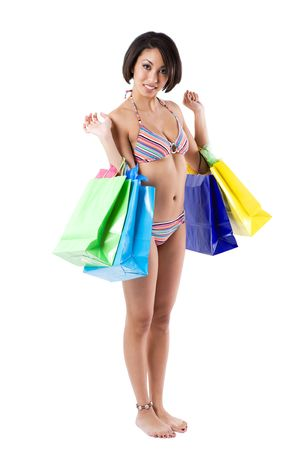 An isolated shot of a beautiful black woman carrying shopping bags Stock Photo - 3098297
