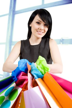 A shot of a beautiful woman carrying shopping bags in a store Stock Photo - 3100863