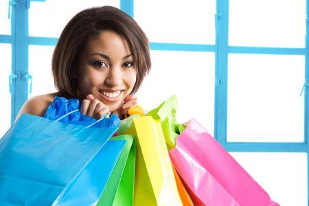 A shot of a beautiful black woman carrying shopping bags photo