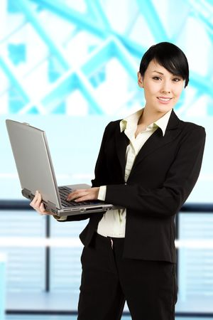 A shot of a beautiful businesswoman holding a laptop working in the office Stock Photo - 3112966