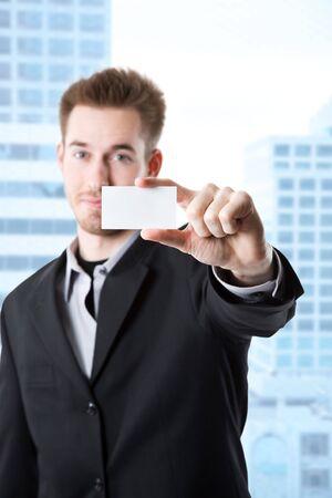 businesscard: A shot of a caucasian businessman holding a business card Stock Photo