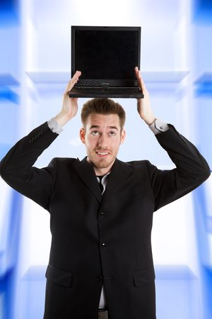 A shot of a caucasian businessman holding a laptop on top of his head Stock Photo - 3120209