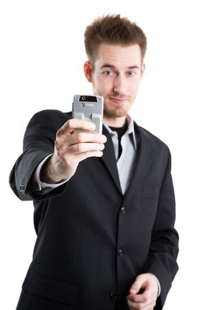 An isolated shot of a caucasian businessman taking picture with his camera phone photo