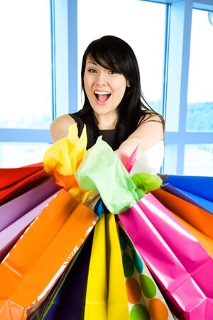 A shot of a beautiful woman carrying shopping bags in a store Stock Photo - 3177710