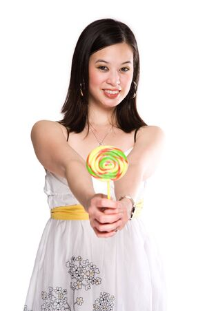 An isolated shot of a beautiful asian woman carrying a lollipop photo