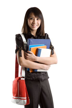 carrying: An isolated shot of a beautiful asian college student carrying books Stock Photo