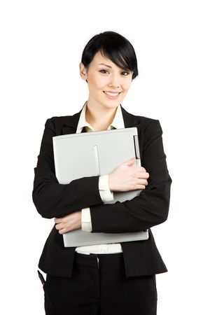 An isolated shot of a beautiful businesswoman carrying a laptop Stock Photo - 3331578