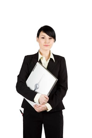 An isolated shot of a beautiful businesswoman holding a laptop Stock Photo - 3331573