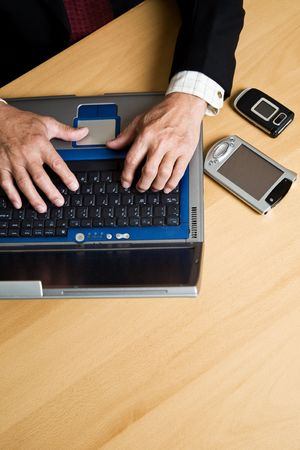 A shot of a businessman working on his laptop Stock Photo