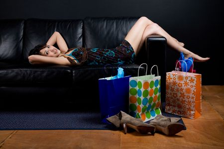 A shot of a beautiful asian woman resting on a couch after shopping Stock Photo - 3383788