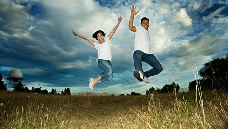 A shot of an asian couple jumping for joy photo