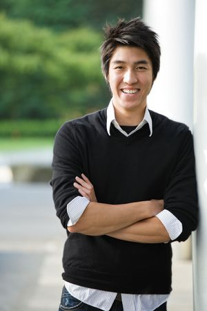 happy asian man: A shot of a happy young asian student