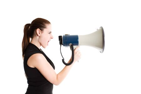 An isolated shot of a caucasian businesswoman shouting through a megaphone photo
