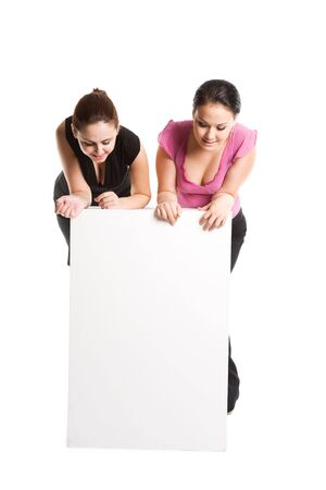 A shot of two businesswomen looking at a blank billboard photo