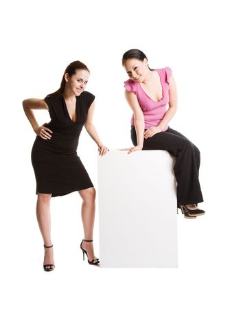 A shot of two businesswomen with a blank billboard photo