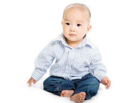 かわいいアジア男の子の赤ちゃん白い背景にショット 写真素材