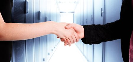 Two businesswomen handshake in a data center photo