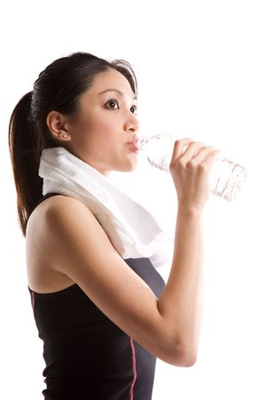 An isolated shot of an asian girl drinking water after exercise photo