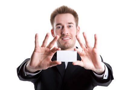 businesscard: An isolated shot of a caucasian businessman showing his business card (focus on the card)
