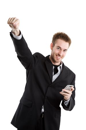 A happy caucasian businessman raising his fist after receiving a text message photo