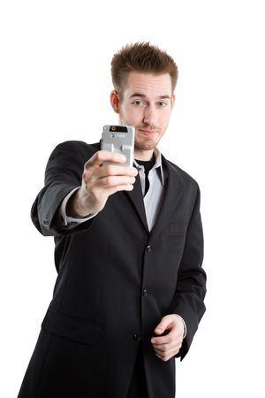 A caucasian businessman taking picture with his camera phone  photo