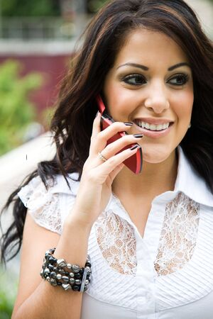 A beautiful hispanic businesswoman talking on the phone photo