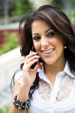 A beautiful hispanic businesswoman talking on the phone photo