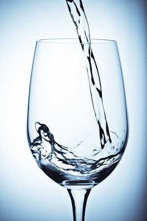 A shot of fresh water poured into a glass