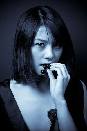 A beautiful asian woman shot in blue tone photo