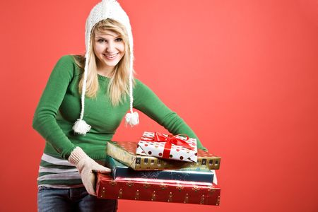 A beautiful caucasian girl carrying gifts during holiday season Stock Photo - 3566226