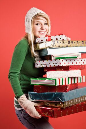A beautiful caucasian girl carrying many gifts during holiday Stock Photo - 3566227