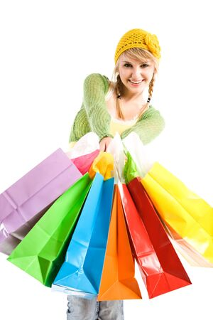 A beautiful caucasian girl carrying shopping bags photo