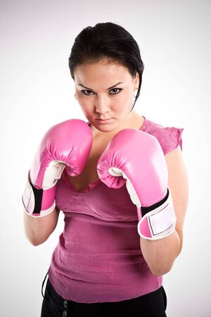 punching: A shot of a businesswoman wearing a pair of boxing gloves Stock Photo