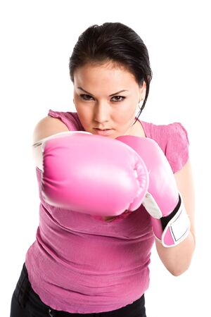 A shot of a businesswoman throwing a punch with boxing gloves photo